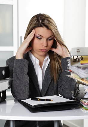 woman doing taxes, getting stressed
